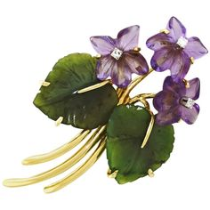Jade Leaf and Amethyst Flower Brooch in Gold | From a unique collection of vintage brooches at https://www.1stdibs.com/jewelry/brooches/brooches/