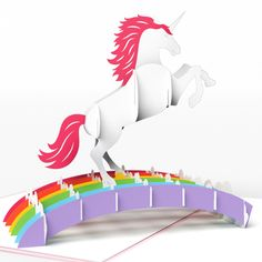 The front of the unicorn birthday card features a shimmery pink cover with a silhouette of a unicorn. Open it up to reveal a majestic unicorn galloping across the top of a rainbow. Glimmering sparkles