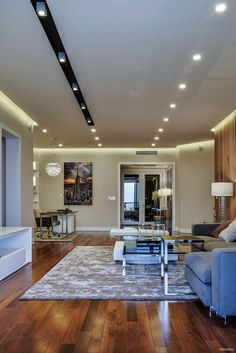 This single family modern apartment is a project designed by YoDezeen. Images by YoDezeen Contemporary Interior Design, Interior Design Living Room, Karton Design, Modern Family, Single Family, Dining Table, Indoor, Cabinet, House