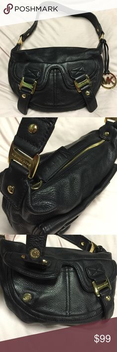 """MICHAEL KORS BLACK LEATHER SHOULDER BAG WITH GOLD MICHAEL KORS BLACK LEATHER SHOULDER BAG WITH GOLD HARDWARE ☺️ IN EXCELLENT CONDITION ❤️ MINOR WEAR ON LOGO MK GOLD TONE CHARM AND BUCKLE MAGNETIC SNAP CLOSURES. INSIDE ZIPPERED POCKET. LINED IN BLACK NYLON FABRIC WITH LOGO DESIGN. SEE EXTRA PHOTOS FOR PICTURES OF INSIDE INTERIOR OF BAG  measurements: 12"""" inches wide  x 8""""inches long by 2 inches deep. Strap length is: 18""""inches  9""""drop. Hugs the body under your arm Michael Kors Bags Shoulder…"""