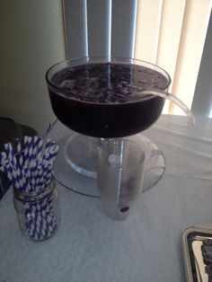 Purple Punch: 1 liter sprite, Welch's grape juice & pineapple juice...frozen grapes to keep punch cold.