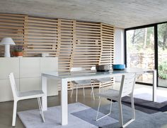 Elegant Ligne Roset Book and Look Rotating Tower Structure resting on a rotating ball bearing mechanism The MDF supportbase is weighted with a steel dis u