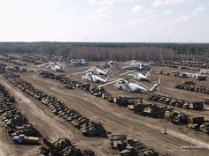 This is the abandoned airfield in Pripyat, Ukraine on the Chernobyl site.  All of those vehicles are sitting there so contaminated by radioactivity they won't be going anywhere anytime soon.