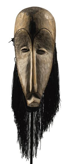 Africa | 'Ngil' mask from the Fang people of Gabon | Wood, pigment and natural fiber | Collected in situ 1917. || Est. 300'000 - 500'000$ ~ (May '15)