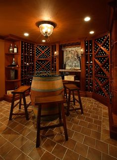 Repurposed wine barrel table for the wine cellar and tasting zone Connoisseurs Delight: 20 Tasting Room Ideas to Complete the Dream Wine Cellar