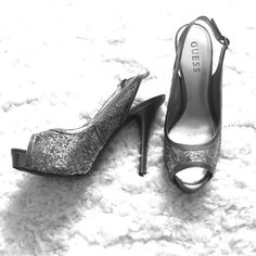 Silver Sparkly Guess Heels-Holiday Parties/Prom! Silver Sparkly Guess Heels for Holiday Parties/Prom!  Worn twice, these are super sassy shoes for a night out. Platinum silver leather trim and silver sparkles make this shoe festive and sexy. Have fun shopping! Guess Shoes Heels