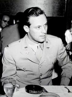 William Holden in uniform at the Stork Club. He served as a 2nd lieutenant in the United States Army Air Forces during World War II, where he acted in training films for the First Motion Picture Unit. https://en.wikipedia.org/wiki/William_Holden