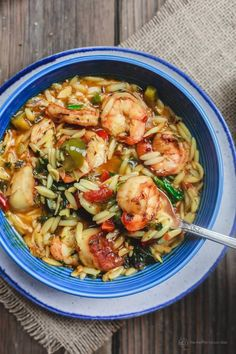 Mediterranean Shrimp Orzo Soup | The Mediterranean Dish. A hearty and healthy orzo soup with vegetables and shrimp. Fresh parsley, dill and oregano give it a wonderful Italian flavor. See this Mediterranean recipe on TheMediterraneanDish.com