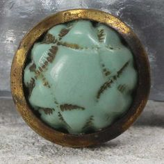 Vintage (1910s) glass set in metal sewing button. Jadeite green colored satin glass. 12mm from https://www.etsy.com/listing/225234064/vintage-jadeite-green-satin-glass-set-in?ref=favs_view_6  Button measures just over 7/16 inch (12mm), self shank.