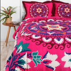 Hot pink duvet and shams! Looks like kinda like Mexican embroidery. Love the colors and the details