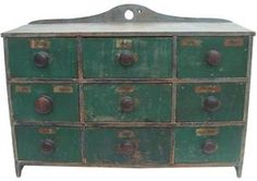 "New England painted pine nine-drawer spice cabinet, retaining an old blue and green painted surface, 17 1/2"" h., 24 1/4"" w."