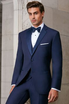 Stand out from the crowd with the Ike Behar Navy Sebastian Tuxedo. Features include a satin notch lapel, soft wool composition, & an elegant two button design to give you a timeless look in a sleek and comfortable navy blue. Class up your wardrobe and rent an Ike Behar Navy Sebastian Tuxedo from President Tuxedo today!