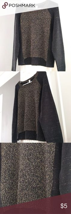 H&M cozy metallic-thread sweater Gently used in excellent condition!  Soft black sweater with golden metallic threading for a chic, trendy look!  Size medium.  Slight high-low hem.  Bust about 42, front length about 21, back length about 23.  Price is firm because it's so low.  Bundle to save 10%! Divided Sweaters Crew & Scoop Necks
