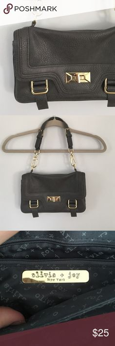 Chic Olivia +Joy purse Small shoulder purse by Olivia + Joy. Universally flattering dark grey with gold hardware to add some interest. Nylon lining is very clean. No rips or stains. Olivia + Joy Bags