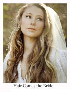 Romantic bridal hair all down wavy bohemian hairstyle with veil by Hair Comes the Bride.