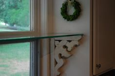 Transformation Tuesday – Antique Corbels Use corbels to make window shelf