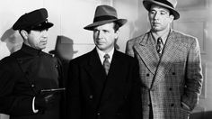 "John Indrisano, Dick Powell, and Mike Mazurki in ""Murder, My Sweet."""