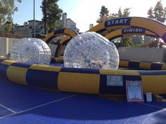 Inflatable Bubble Ball Race Track is a fun and exciting game that is great for almost all ages. This unique inflatable game is good for big events like school carnivals, corporate events, fundraisers and fairs. Call Magic Jump Rentals at 800-873-8989 for more information or to rent.