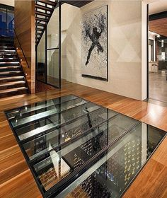 For keeping an eye on your cellar. Pent House, My House, Walking On Glass, Luxury Staircase, Wine Cellar Design, Home Bar Designs, Luxury Girl, Hidden Rooms, Glass Floor