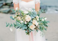 Eucalyptus and peach rose bridal bouquet | Kristina Malmqvist Photography | see more on:  http://burnettsboards.com/2015/07/demure-beach-wedding/