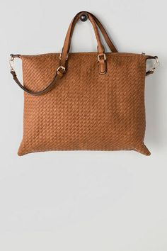 Francesca's large woven satchel is perfect for a day out running errands or for travelling!  A woven texture adds sophistication to this satchel finished with faux gold hardware, an inner zipper pocket, two open pockets & an optional long strap.  Perfect for fall! (or any season.)