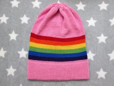This is a soft, cozy, slouchy knit hat. The hat has a base color of pink, with stripes of red, orange, yellow, green, blue, and purple, the colors of the rainbow LGBT pride flag. The yarn is 100% acrylic, suitable for those with wool allergies. Wear this hat with pride! This hat is