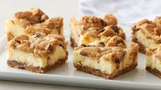 Chocolate Chip Cheesecake Bars The best of all possible worlds -- creamy cheesecake filling on a chocolaty crust made easy with Pillsbury® cookie dough. Chocolate Chip Cheesecake Bars, Chocolate Chip Cookies, Cookie Cheesecake, Chocolate Chips, Pistachio Cheesecake, Cheesecake Squares, Pumpkin Cheesecake, White Chocolate, Huevos Rancheros
