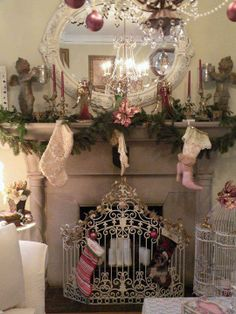 Super sparkly vintage-style mantle with a classic faux Period look combining soft pinks, putty and ivory with a little gold and green foliage.  White ironwork bird cage and fire guard complete the look.