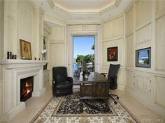 Home office with large fireplace - waterfront.  Moorings in Naples, Florida