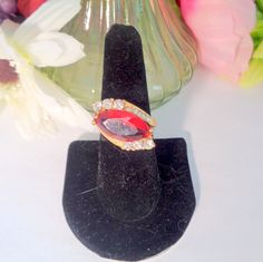 Vintage Large Diamond Shaped Faux Red Ruby and Clear Rhinestone Ring in a Size 10 that is Set in Goldtone Metal.