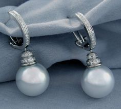 Large South Sea pearls dangle in white gold and diamonds. South Sea pearls come from large oysters (up to 12 inches in diameter) that only live in the area of the ocean between the north edge of Australia and the southern edge of China. Custom Earrings, Custom Jewelry Design, South Sea Pearls, June Birth Stone, Oysters, Sterling Silver Pendants, Birthstones, Dangles, Southern