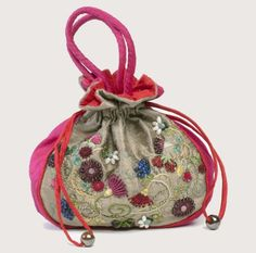 Camilles Bag is a truly stunning, one of kind purse of the highest quality that has been completely designed, sewn, and hand-embroidered by me.