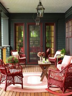 Dark paint with red trim and matching wicker, lanterns