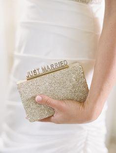 "Gold ""Just Married"" Kate Spade Clutch | Paloma Blanca | Abby Jiu Photography https://www.theknot.com/marketplace/abby-jiu-photography-washington-dc-613164"