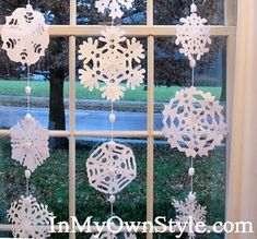 """DIY snowflake garland - easy (uses coffee filters and """"snowball"""" yarn).  Also links to snowflake patterns."""