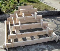 Simple to build wooden structure for a tiered herb garden. - if only I had sun in my yard....