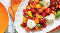 A Caprese salad—tomatoes, basil, and fresh mozzarella cheese—is one of the easiest and most delicious ways to show off peak-season Southern-grown