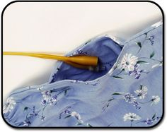 Feeding and Drainage Tube Opening Small openings in shirts or dresses are concealed with a mock pocket to accommodate feeding and drainage tubes.