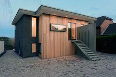 Двухэтажный дом из дерева и серого кирпича от студии AR Design Studio