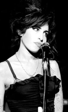 Amy Winehouse | Paparazzi, Content, B&W, Silver Necklace, Black Frilly Dress, Beehive