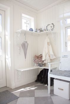 hooks under the shelf instead of on the wall, interesting idea. The diamonds on the floor. Omg. So cute! What about just painting the cement something cute this this? Or staining it