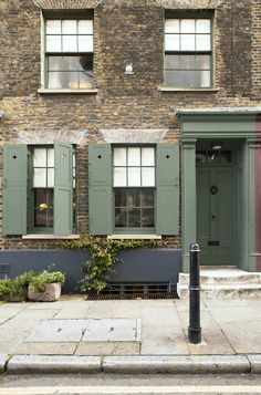 Facade, exterior woodwork and door painted in Farrow & Ball Green Smoke. Render beneath windows in Off-Black. Image from Decorating with Colour.