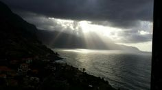 sunshine breaking through the clouds above the Atlantoc