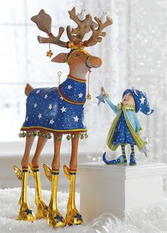 The Patience Brewster Comet Dash Away Reindeer Character offers a whimsical touch to your holiday display and features hand-painted details that are sure to delight your guests.