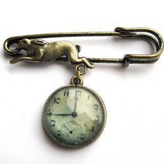 This is a gorgeous brooch featuring a brass hare and a clock face taken from a photograph of a Victorian timepiece. The image has been printed with archival pigment ink and sealed for longevity, then encased behind a glass cabochon. Antique Clocks, Or Antique, Vintage Clocks, Antique Keys, Vintage Antiques, Vintage Items, Vintage Pins, Cool Clocks, Telling Time