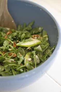 simple arugula salad with thin apple slices, feta cheese, candied walnuts and lemon vinaigrette (2 parts olive oil, 1 part lemon juice and a dash of salt)... I would use parmesan or goat cheese instead of feta