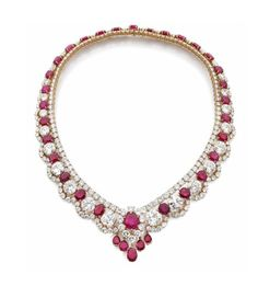 A RUBY, DIAMOND AND YELLOW GOLD NECKLACE BY VAN CLEEF & ARPELS