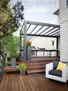 Outside of the steel pergola and rail structure, this layout of backyard steps is relatively on par with what will likely happen at the L² Design Lab. The eating and cooking space is relegated to the upper deck, likely closer to the back door, and the lounging space becomes further removed. Love it.