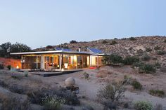 House in Pioneertown, United States. The Off-grid itHouse brings together raw industrial aesthetics with the tactics of green design to forge a new home in the sunbaked wilds of the California high desert.   The Off-grid itHouse is an architecturally significant house, recently noted...