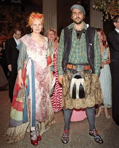 Vivienne Westwood and her husband at the Met Gala. Charlotte Moss standing behind them.